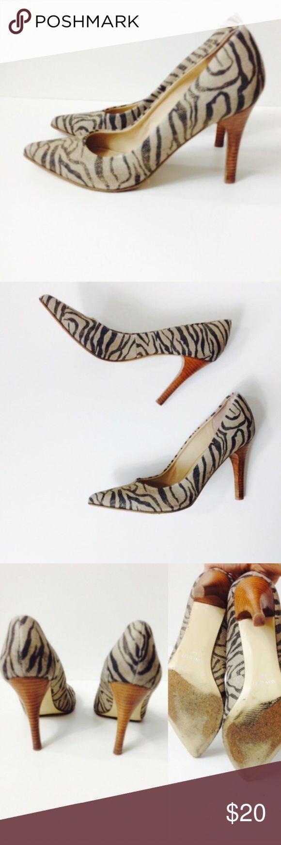 Nine West animal print zebra heels Nine West animal print zebra heels; some dirt on back left shoe and a defect on the heel - see pics Nine West Shoes Heels