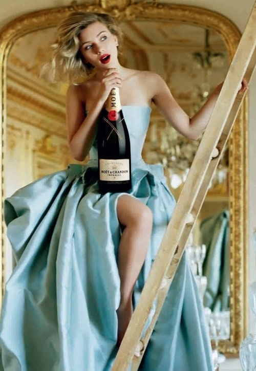 Scarlett Johansson with Moet et Chandon ~ OK Scarlett, convince people that being an Alcoholic is classy!