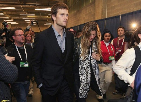 New England Patriots quarterback Tom Brady and his wife, Gisele Bundchen, leave the stadium after the Patriots' 21-17 loss to the New York G...