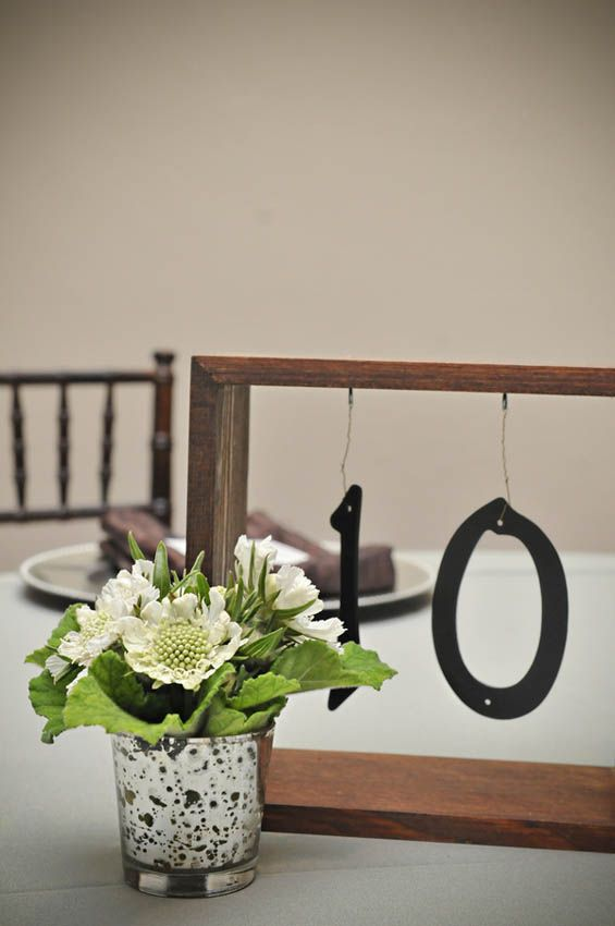 Delicate table numbers bring the outdoors vintage feel into the Ballroom