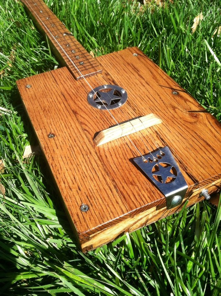 DIY PALLET WOOD GUITAR - My husband and I were first inspired by some Cigar Box Guitars that we saw at our local flea market.  With a little research on our own