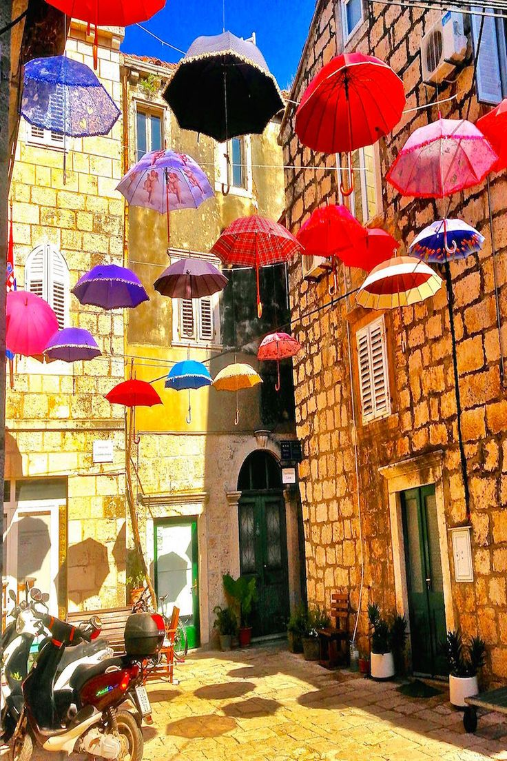 A colorful umbrella courtyard in Korcula Croatia