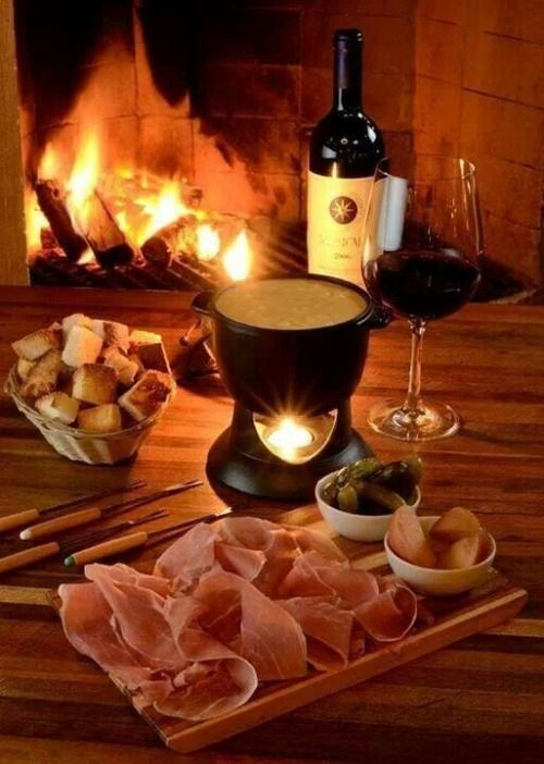Fondue and wine by the fireplace on a cold evening