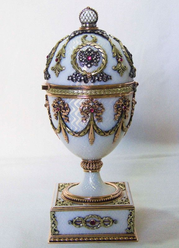 This is the last Fabergé egg not much is known about this one either. It was made some time before 1896. This egg is covered in white, translucent enamel over a guilloché ground. The decorations in four-colored gold, diamonds and rubies.