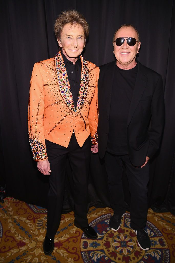Barry Manilow and Michael Kors pose backstage during Michael Kors