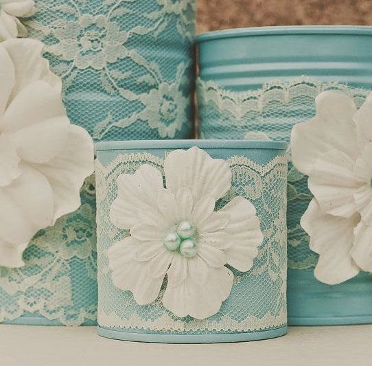 Painted tins, doilies and crafting flowers....this is such a super sweet wedding decoration idea!