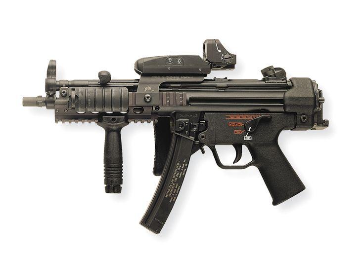 http://shootingillustrated.com/wp-content/uploads/2010/10/MP5A3-w-KAC-forearm.jpg