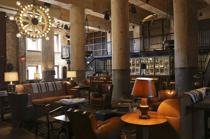 Roman and Williams designed The Sternewirth bar at the Hotel Emma includes a 25-foot ceiling, repurposed cast-iron fermentation tanks that now serve as lounge seating and a repurposed bottle labeler made into a chandelier. Photo: Jerry Lara /San Antonio Express-News / © 2015 San Antonio Express-News
