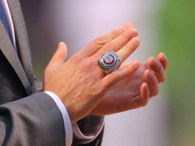 Apr 12, 2017; Chicago, IL, USA; The 2016 World Series championship ring on the hand of Chicago Cubs president of business operations Crane Kenney before the game against the Los Angeles Dodgers at Wrigley Field. Mandatory Credit: Dennis Wierzbicki-USA TODAY Sports