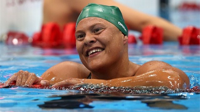 Natalie du Toit of South Africa celebrates winning gold