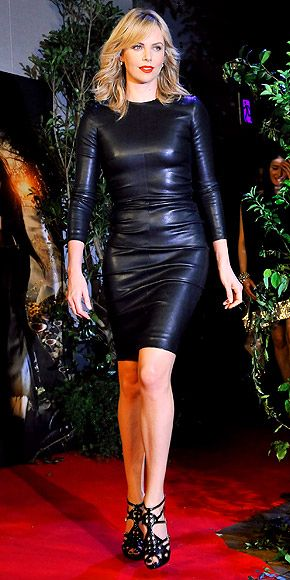 """Charlize Theron of """"Snow White and the Huntsman"""" strolled in front of photographers with a stunning black ensemble called The Row leather sheath dress. Her diamond rings are from Dana Rebecca Design that nicely coincide with some high heels that are amazing in design and style."""