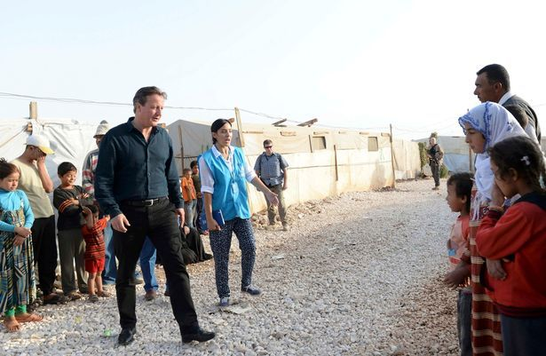 Prime Minister David Cameron meets Syrian refugee families in a settlement camp in the Bekaa Valley in Lebanon