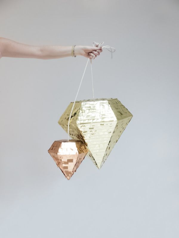 This blingy piñata is a must for any bridal shower, bachelorette bash, or no-holds-barred reception. Handmade in San Diego, it comes with natural cotton rope. Choose from two sizes and four colors: gold, copper, silver, or black.