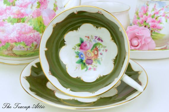 This lovely deep moss green teacup with a brilliant white background and colorful bouquets on the cup and saucer is really a fantastic piece. Fantastic curves of color that marry the rich green and the bright white so elegantly. This set is in very good vintage condition with no