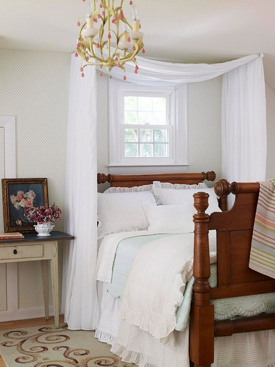 A simple swag of fabric loosely draped over two swing-arm curtain rods positioned just below the ceiling gives this cozy cottage room a romantic and elegant finish.: Guest Room, Small Bedroom, Bedrooms, Master Bedroom, Canopies, Bedroom Ideas