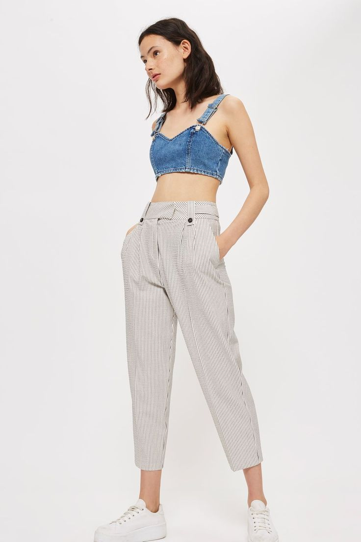 Lightweight trousers are a must as the weather gets warmer. We're going to be wearing these chic striped peg trousers all summer long, and we're loving the cute button detail to the waist. Cropped at the ankle bone for a leg-lengthening look, we're finishing with trainers for casual-cool.