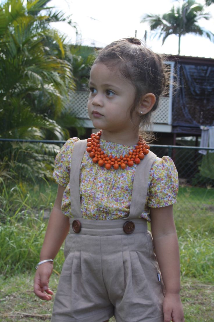 Little model wearing Orange Round Collar Necklace complimented by Lacey Lane