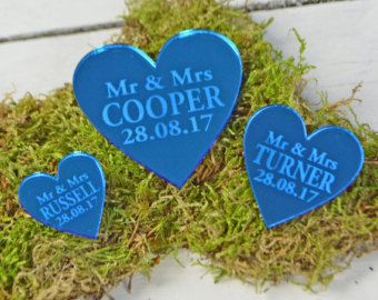 50 PERSONALISED LOVE HEART WEDDING RECEPTION TABLE DECORATIONS OR WEDDING FAVOURS 2CM by Secret Creation  Personalised heart shaped wedding table decorations/favours perfect for adding some romance and a personal touch to your wedding table. Perfect for a Royal Blue Wedding Theme. We recommend if you are using these as table scatters, for tables seating 6-8 people to use between 20-50 per table. If you do require more than 50 please select multiple quantities in the listing. Also perfect to…