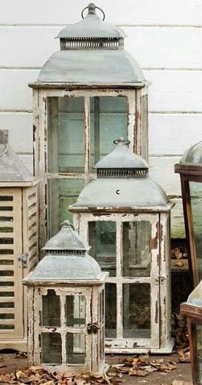 Lanterns - mismatched  vintage looking lanterns, filled with mixed green stones and moss and  some sparkle and lanzias