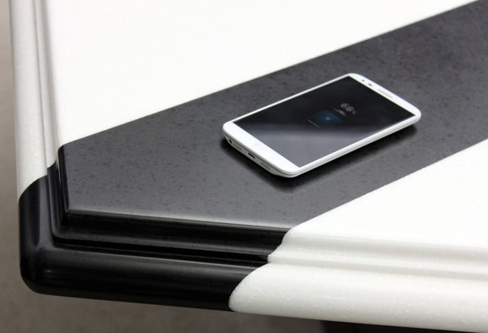 Where's the phone charger? It's mounted discreetly under the countertop, allowing smartphones with Qi wireless-charging technology or a Qi-enabled case to recharge simply by placing them on the right spot. TechTop is an embedded surface technology for wireless charging that works with LG Hausys' HI-MACS solid surface and Viatera Quartz as well as wood and laminate products. Ready to cut the cord? For info, visit lgtechtop.com.