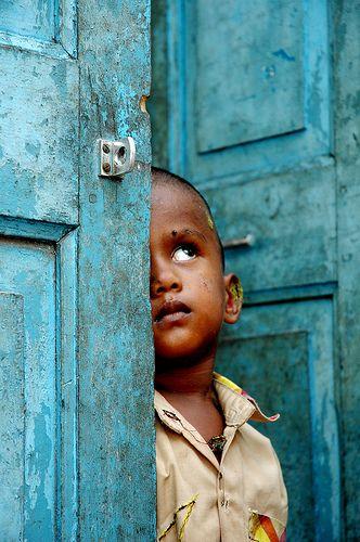 little boy...in the blue door...India