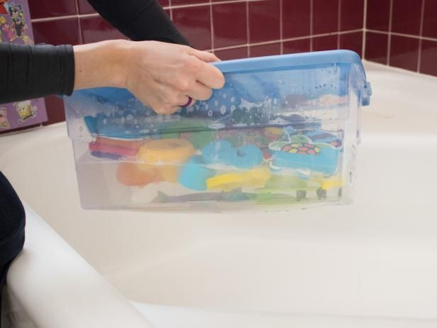 DIY Network shows you how to use vinegar and tea tree oil-based solutions to clean the inside and outside of your kids' bath toys.