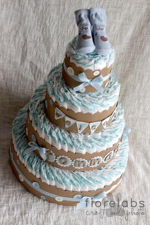 Altra torta di pannolini, altri colori... avorio, azzurro baby e kraft per il piccolo Tommaso che domenica ha ricevuto il S. Battesimo. ...