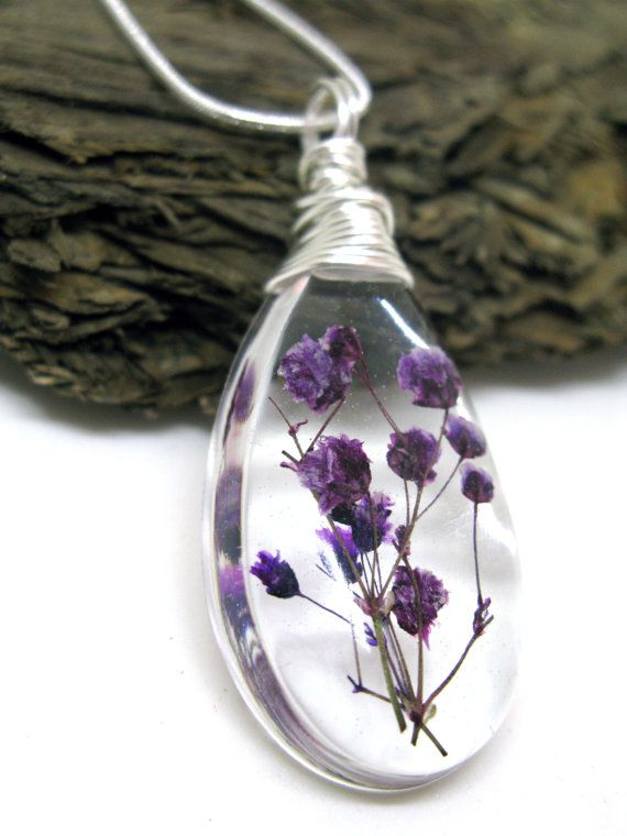 This listing is for a lovely pendant of lovely purple babys breath flowers in jewelers grade resin. The pendant is a teardrop shape. I have wire wrapped a tarnish resistant silver plated wire through the pendant that acts as a bail. This is a sweet delicate piece perfect for Mothers Day!  The pendant measures about 1 3/4 tall by 7/8 wide and about 1/4 deep (about 41mm x 22mm x 7mm) and comes with an 18 silver plated snake chain with lobster clasp. *** Each finished jewelry listing will…