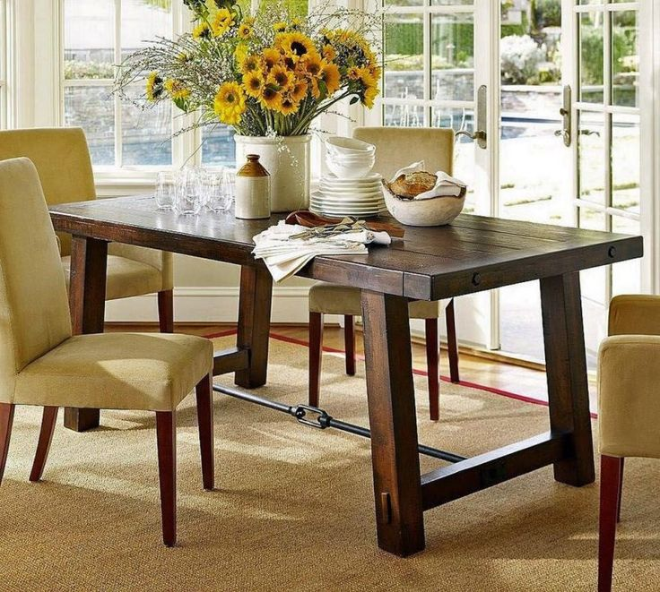 Dining Room Sunflowers With Flower Vase Also Cherry Wooden Dining Table And Cream Futon Dining Table Besides Water Glass  Ceramic Bowl  Carpet  Glass Window  Door   Basic Tips to Arrange Table in Dining Room