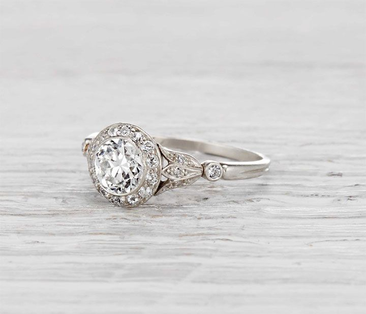 Vintage Edwardian J.E. Caldwell engagement ring made in platinum and centered with a .75 carat old European cut diamond. Halo style with petal motif shank ~ we ❤ this! moncheribridals.com