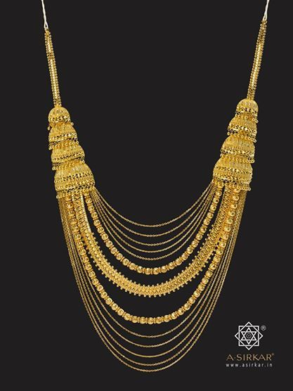 "Festival Necklace. A glorious cascade necklace with thirteen differentiated rows of chains (signifying the ""Tero Parbon"", or thirteen festivals, of the Bengalis) that are detachable in parts and can be worn separately as three individual neck-pieces. The jhumka steps also hide a link that enables the whole ornament to become smaller so that it can be worn close around the neck."