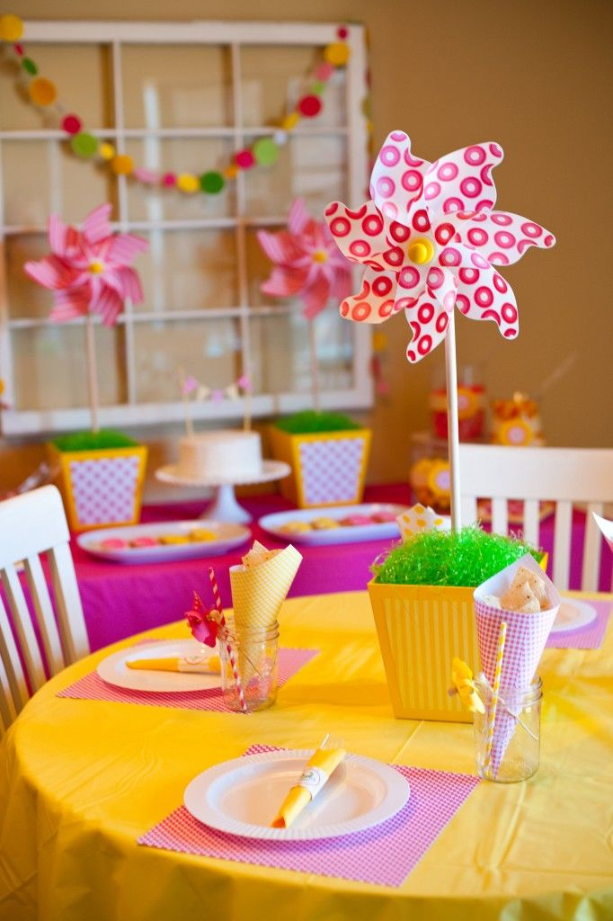 pink and yellow pinwheel decorations for a Spring inspired Birthday party