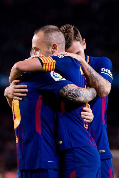 Marvelous Andres Iniesta C of FC Barcelona celebrates with his teammates Lionel Messi L