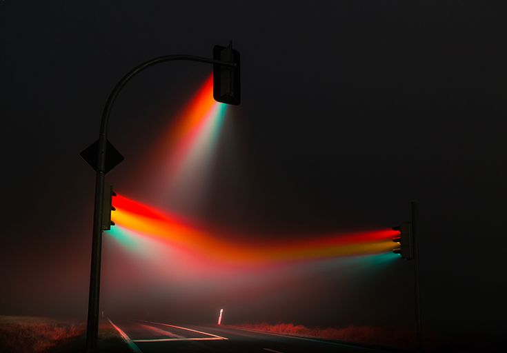 lucas zimmermann's surreal traffic lights illuminate misty german streets