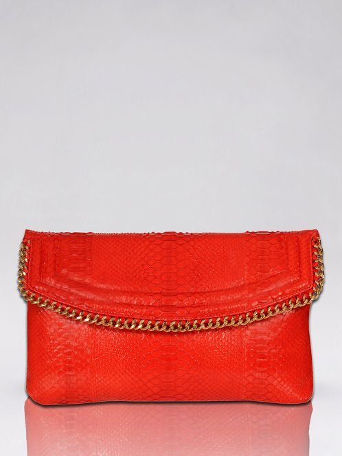 https://www.cityblis.com/1351/item/14610  Topanga (Python) - $900 by CASHHIMI  %100 Python Clutch with magnetic flap closure decorated by chain adornment convex detailing (gold or silver plated). Main compartment contains 1 slip pocket inside. Interior consist of leather lining. Entirely hand crafted.