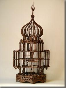 An Orientaliste natural wood birdcage