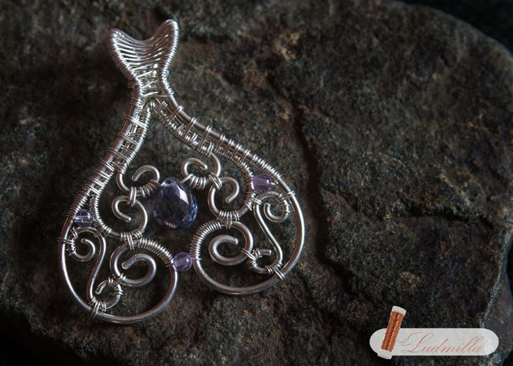 Silver wire-wrap pendant with topaz and amethyst.