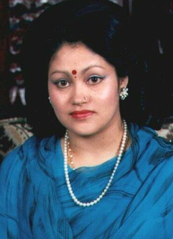 Queen Aishwarya of Nepal was shot dead along with her husband, King Birendra; her son, Prince Nirajan; her daughter, Princess Shruti; and seven other royal family members. It is widely believed that the motive for the Queen's murder was her strong opposition to the Crown Prince's proposed marriage to Devyani Rana. Her face was so badly disfigured by the gunshot wound that, for the widely attended state funeral procession, it was covered by a china doll bearing her likeness.