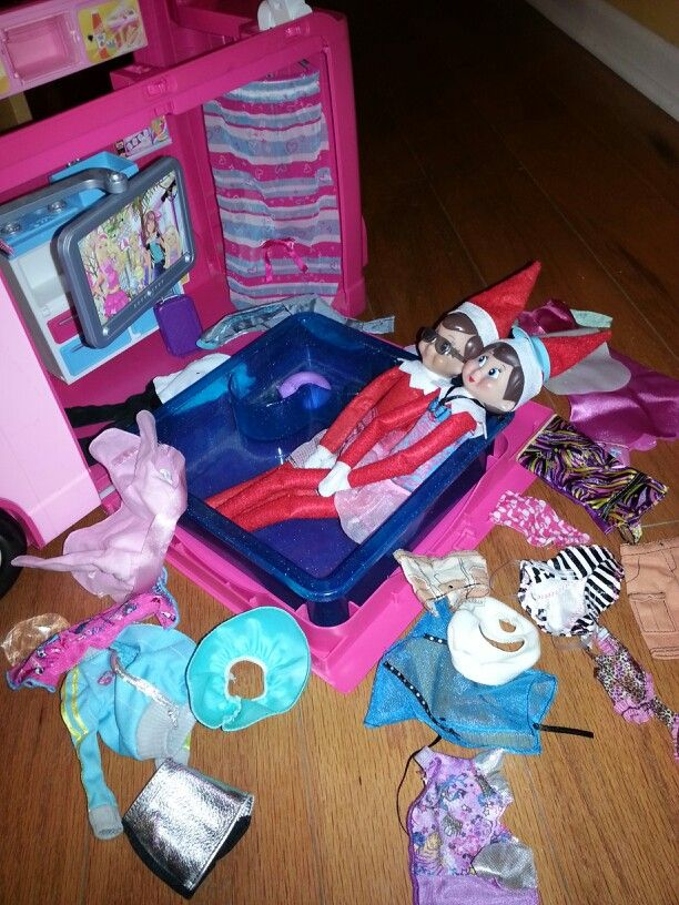 Buddy and Emma (Elf on the Shelf) are hanging out in the Barbie hot tub watching T.V. Note:  Barbie clothes fit the Elves on the Shelf great!!