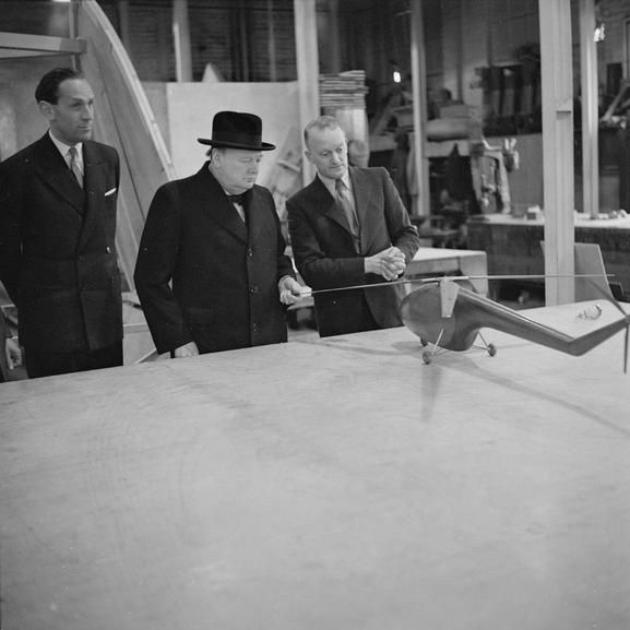 WINSTON CHURCHILL DURING SECOND WORLD WAR (H 41775) The Prime Minister, Mr Winston Churchill, examines the model of a helicopter at the Bristol Aeroplane Company's works at Filton.