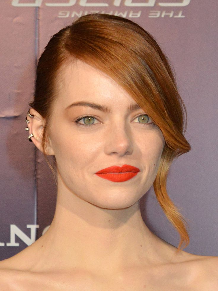 For the Amazing Spider-Man 2 premiere in Paris, Emma Stone opted for an edgy beauty look with a matte orange lip, spiraled fringe, and an ear cuff.