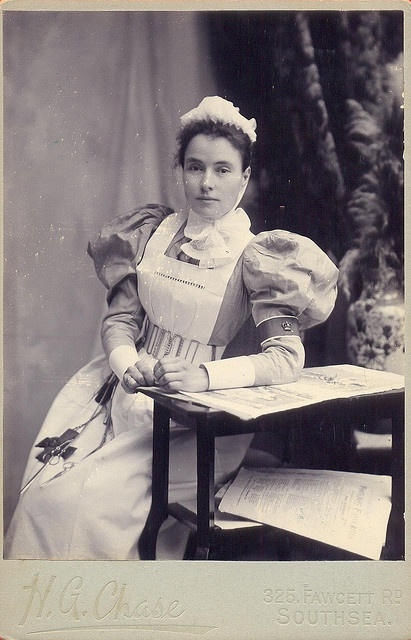 Victorian/Edwardian nurse. Photo shows her chatelaine with scissors,forceps,etc.  (by backmanmal)