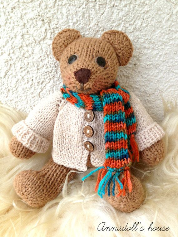 Knitting Pattern For Teddy Bear Scarf : Knitted Teddy Bear Toy with white knitted jacket and a striped scarf Jacket...