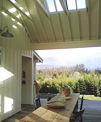 dogtrot between kitchen & garage, like the addition of the skylights as well...