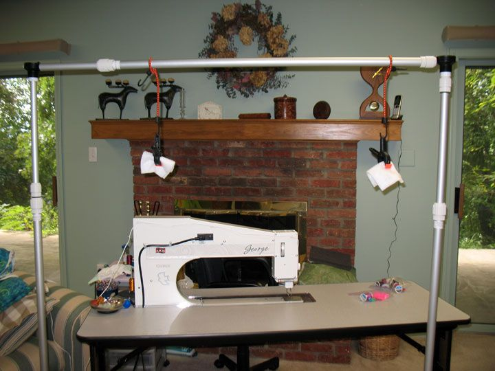 Quilt suspension system using telescoping vertical poles on a bottom base, bungee cords, and clamps | Patsy Thompson