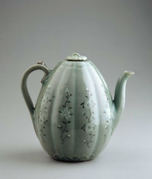Melon-shaped Ewer  Korean  13th century  Height: 20.3 cm (8.0 in.), Diameter of lid: 3.7 cm (1 7/16 in.), Diameter of foot: 8.0 cm (3 1/8 in.)  Glazed stoneware with inlaid and incised decoration  Classification: Ceramics