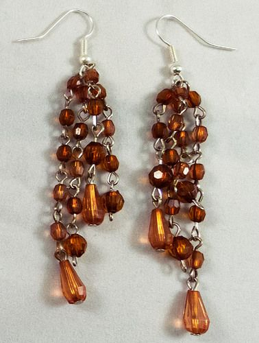 These are beautiful silver earrings made with transparent brown beads. They measure at 7 cm.