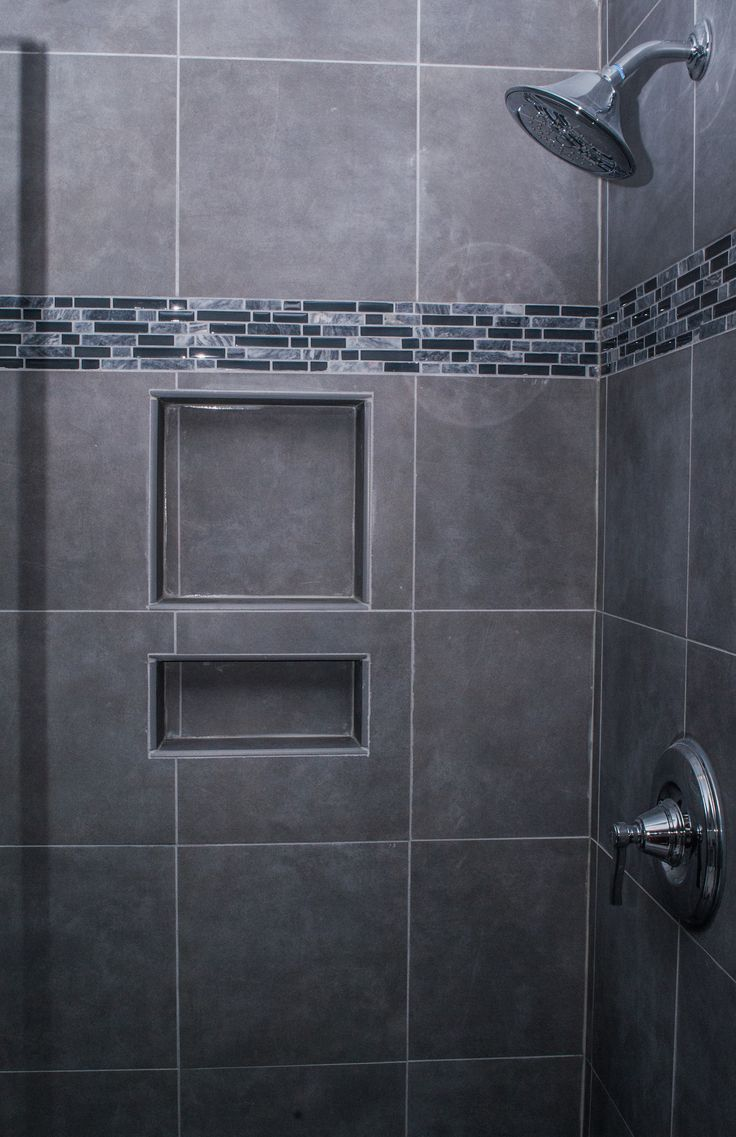 I like this shower! Gray tile, tiny subway tiles, built-in shelves!