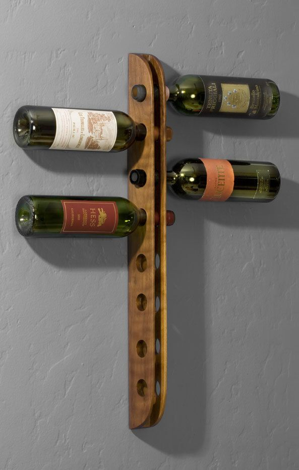Wall mounted walnut wine rack. $90.00, via Etsy.