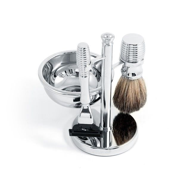 Chrome Stand Shaving Set with Soap Dish - A wonderful addition to any bathroom, this shaving set is functional and stylish. This handsome set includes a Mach 3 razor (blade not included), genuine badger hair shaving brush with soap dish, and a matching display stand. Constructed from stainless steel and finished off with chrome plating, the set features lined etching which adds a touch of elegance to the design.